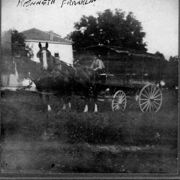 Wildwood Historical Society - Kenneth Franklin - Driving large wagon and team of horses Franklin house in Grover background - 1922