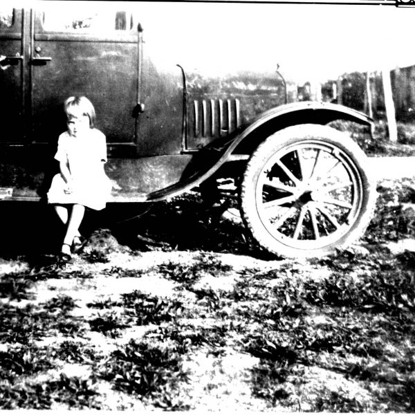 Wildwood Historical Society - Dovie Lavern Poertner - Dovie Lavern Poertner Sitting on and a running board - 1929